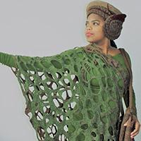 Groene opengewerkte jurk + bruine accessoires